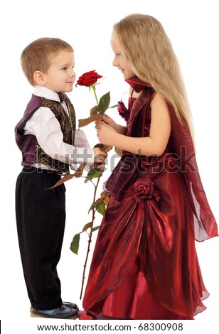Little boy gives a girl a rose, isolated on white - stock photo