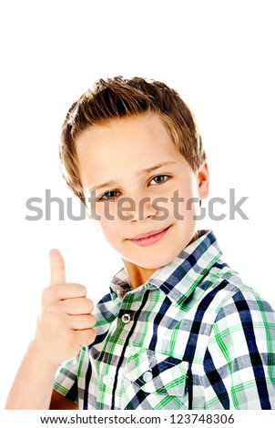 little boy giving a thumbs up - stock photo