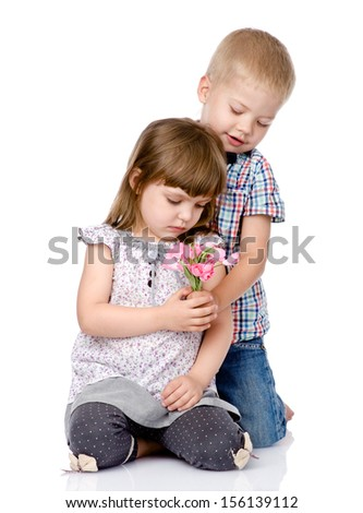Little boy giving flowers to girl. isolated on white background - stock photo