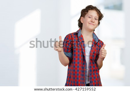 Little boy giving the thumbs-up sign - stock photo