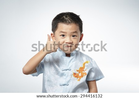 little boy giving you thumbs up - stock photo