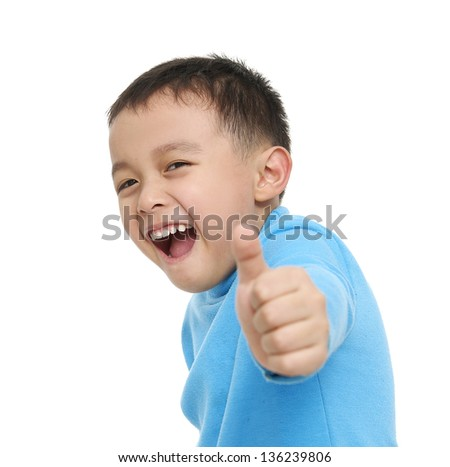 little boy giving you thumbs up �close up - stock photo