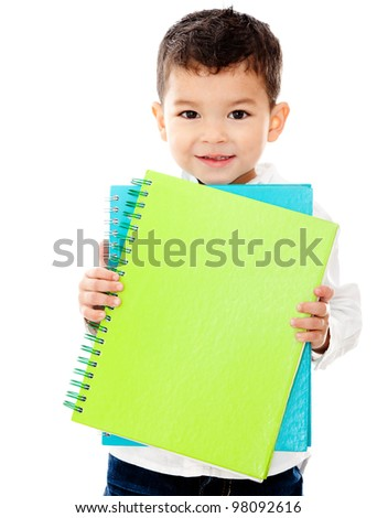 Little boy going to school holding notebooks - isolated over a white background - stock photo