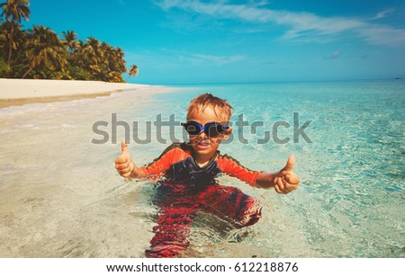 little boy having fun on tropical beach