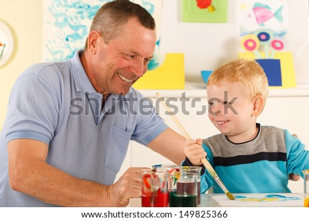 Little boy having fun with his grandfather - stock photo