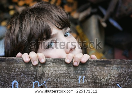 little boy hide  in his secret place  - stock photo