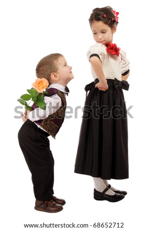 Little boy hides from the girl a yellow rose, isolated on white - stock photo