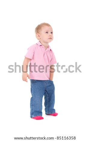 Little boy hold hand in pocket look up isolated over white background - stock photo