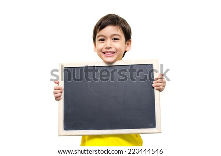 Little boy holding a blackboard over white background - stock photo