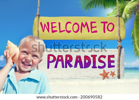 Little Boy Holding a Seashell with Welcome Sign - stock photo