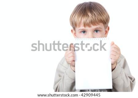 little boy holding notebook - isolated on white background - stock photo