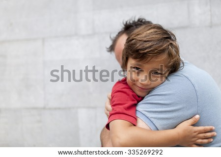 little boy hugging his dad