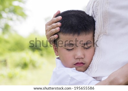 little Boy hugging his mother - stock photo