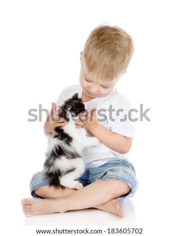 little boy hugging kitten. isolated on white background - stock photo