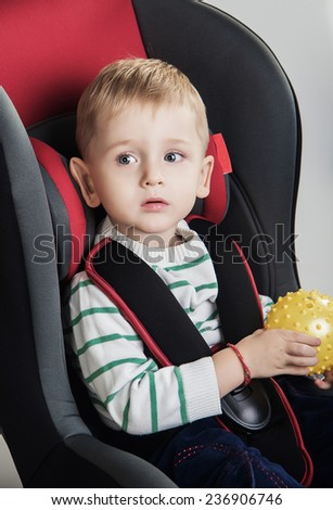 little boy in a a car seat