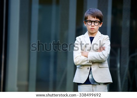 Little boy in a nice suit and glasses. Back to school. Children portrait. Stylish kid in suit - stock photo