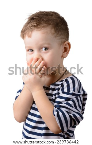 little boy in a striped vest closed mouth with hands - stock photo