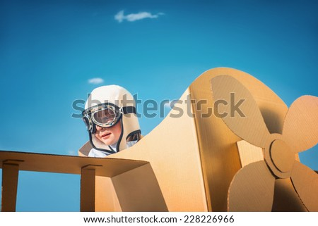 Little boy in an airplane - stock photo