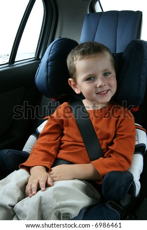 little boy in car safety seat - stock photo