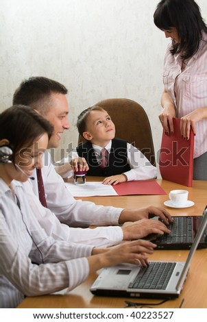 Little boy in charge of a company - stock photo
