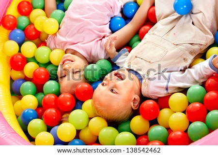Little boy in colored ball.