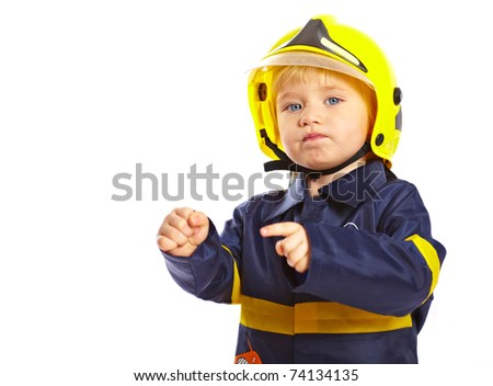 Little boy in fireman costume and helmet isolated on white background - stock photo