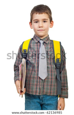 Little boy in first day on school holding bag and books isolated on white background - stock photo