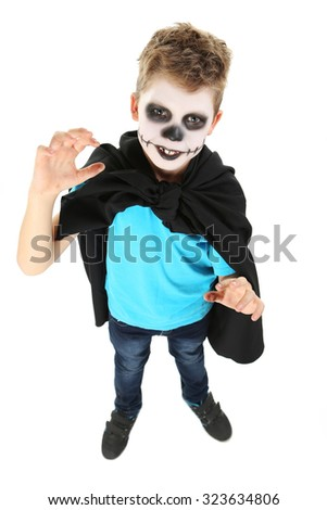 Little boy in halloween costume on white background