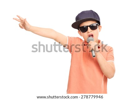 Little boy in hip hop outfit rapping on a microphone and gesturing with his hand isolated on white background - stock photo