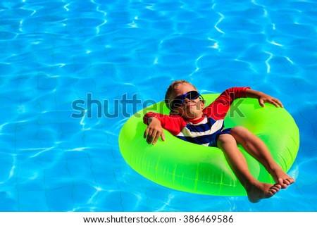 little boy in life ring having fun on beach - stock photo