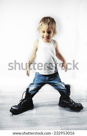 Little boy in military boots - stock photo