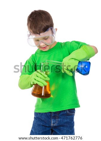 Little boy in protective glasses and gloves mixing a two chemical liquids in flask, isolated on white