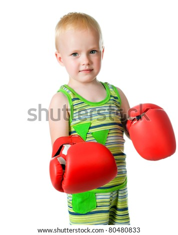 little boy in red boxing gloves on white background - stock photo