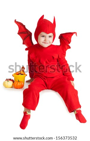 little boy in red devil costume sitting with pumpkins over white background - stock photo