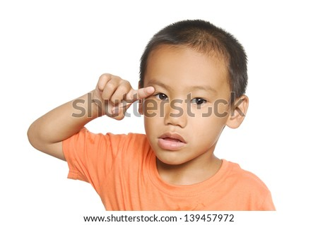 Little boy in round spectacles raising finger in funny attention gesture