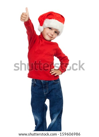 Little boy in Santa hat with thumbs up sign, isolated on white - stock photo