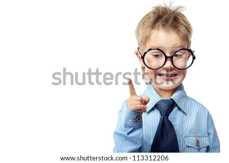 Little boy in spectacles and suit pointing the finger at something. Isolated over white background. - stock photo