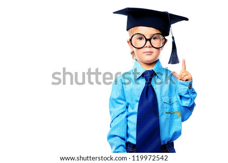 Little boy in spectacles and suit pointing the finger at something. Isolated over white background.