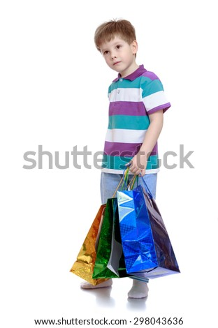 Little boy in striped t-shirt holding bags for shopping-Isolated on white background