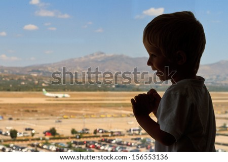 little boy in the airport - stock photo