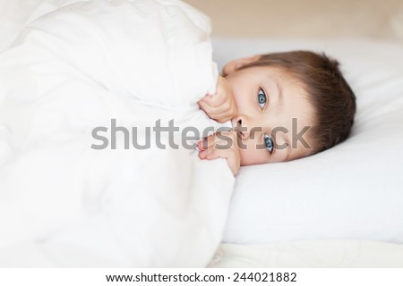 little boy in the bed sleeping daytime - stock photo