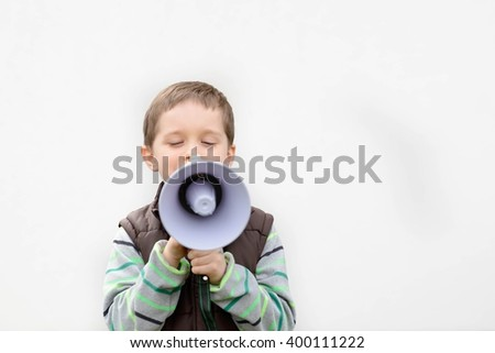 Little boy in the brown vest shouts something into the megaphone - white background