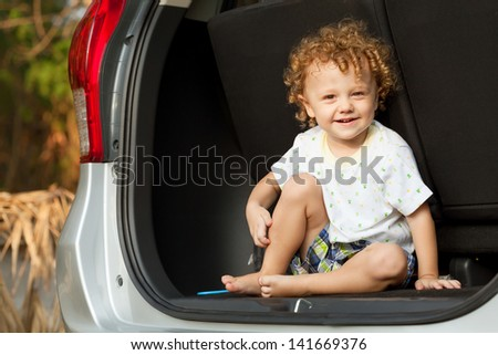 little boy in the car - stock photo