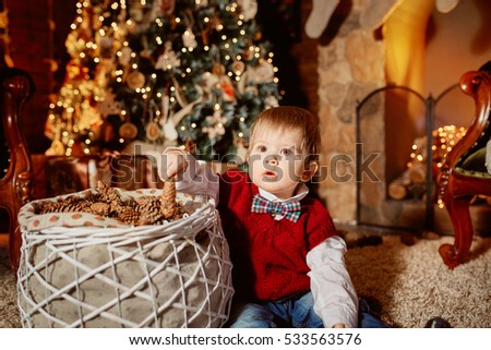 little boy in the Christmas fireplace
