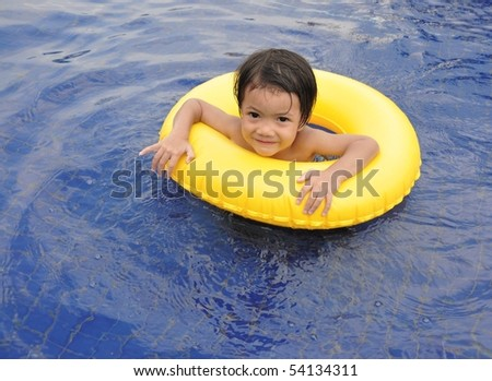 Little boy in the pool - stock photo