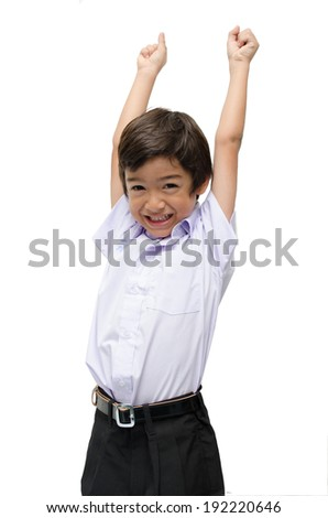 Little boy in uniform ready for school hands up - stock photo