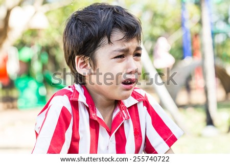 little boy is crying because Bleeding at his mouth - stock photo