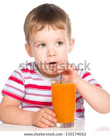 Little boy is drinking carrot juice using straw, isolated over white - stock photo