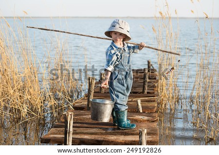 Fisherman fishing pier stock photos images pictures for Little boy fishing