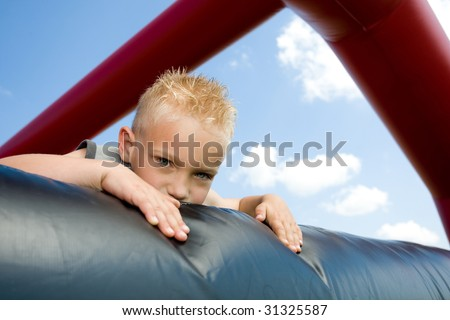 Little boy is looking over the edge. - stock photo